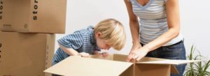 boy peering into empty box, moving house
